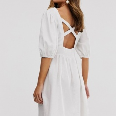 https://www.asos.com/asos-design/asos-design-button-through-linen-mini-dress-with-cross-back/prd/12718177?colourwayid=16441155&SearchQuery=linen%20dresses