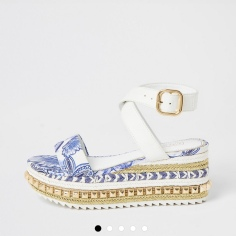 https://www.riverisland.com/p/blue-printed-studded-flatform-sandals-795764?gclsrc=aw.ds&&gclid=Cj0KCQjw6PD3BRDPARIsAN8pHuENEmp9ezU4jJ86uRiVq61vMPdg7_XGBU42jYqUWVS_A1jyRxaK860aAiiaEALw_wcB